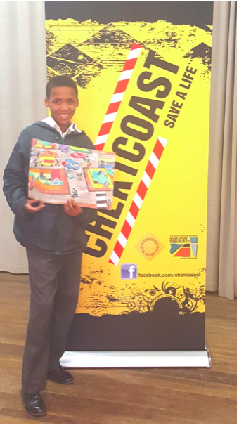 Johntra Persens, a Grade 7 learner of Brandvlei Primary School in the Northern Cape shows off his winning entry. He is a category winner of the SANRAL road safety art competition for which he received a R5000 voucher.